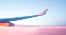 plane wing in pink skies